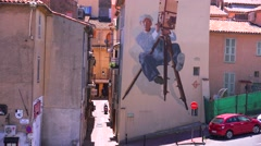 Buildings are painted with images of film stars during the Cannes Film Festival. - stock footage
