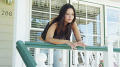 Mixed race woman leaning on rail Stock Footage