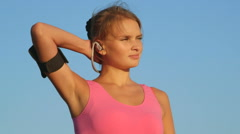 Fitness woman on workout with earphones and sport smartphone armband Stock Footage