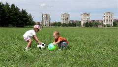 Children playing with balls. Kids takes the ball and running with her. Field. - stock footage