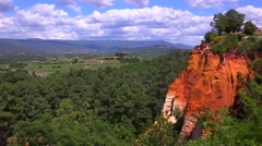 Bright red cliffs near the town of Roussillon in Provence, France. Stock Footage