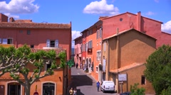 The quaint French hill town of Roussillon France with it's colorful buildings is - stock footage