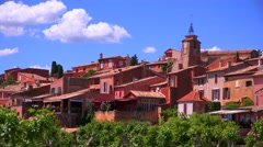 The French hill town of Roussillon France with it's colorful buildings is a - stock footage