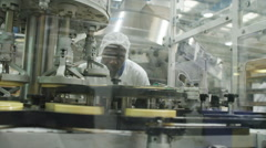 Factory worker inspects products Stock Footage