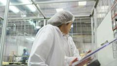 Pharmaceutical factory quality control staff Stock Footage