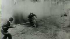 1930's motorcycle hill climb 2--From 1930's film - stock footage