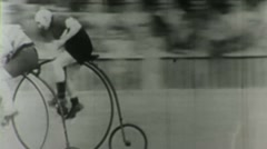 Two vintage high wheel bicycles racing. From 1930's film Stock Footage