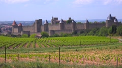 The beautiful castle fort at Carcassonne France with fields foreground. - stock footage