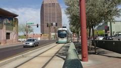 Phoenix light rail leaving red light and slowing for station Stock Footage
