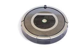 Robotics - the automated robot the vacuum cleaner on a white background. Stock Photos