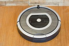 robotics - the automated robot the vacuum cleaner. - stock photo