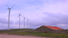 Windmills generate electricity in the hills of Spain. - stock footage