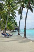 Couple on honeymoon relax on aitutaki lagoon Stock Photos