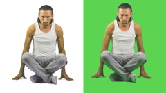Man meditating, green, white background Stock Footage