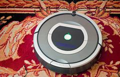 Robotics - the automated robot the vacuum cleaner. Stock Photos