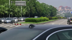 Group of high end cars driven on Chinese suburban road Stock Footage