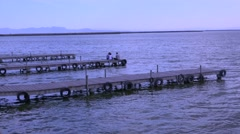 Piers and jetties jut out into the beautiful lake of Albufera, Spain. Stock Footage