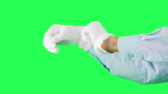white-gloved hands on a green background dancing  - stock footage