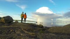 Tourists under rainbow Stock Footage