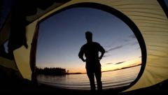 Tourist silhouette from camping tent Stock Footage