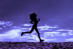 Silhouette of a girl runner effect films - stock photo