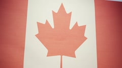 Canadian Flag, Maple Leaf, l'Unifolié, waving in the wind.  Canada. Stock Footage