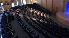 A beautiful auditorium at an oceanographic institute features an aquarium Stock Footage
