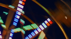 Motin Blurred Illuminated Ferris Wheel and Moon Stock Footage
