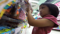 Baby and children to happy to shopping in toy section Stock Footage