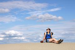 girl hiker is resting in the desert - stock photo