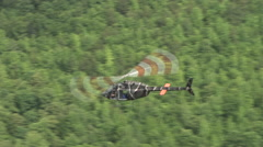 Kiowa OH-58 helicopter in the air Stock Footage