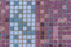 old mosaic tiles of different colors lined verticaly - stock photo
