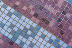 Old mosaic tiles of different shades lined  diagonal Stock Photos