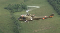 Huey gunship flying on a mission Stock Footage