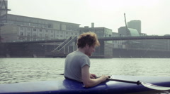 Young man sitting in kayak - stock footage