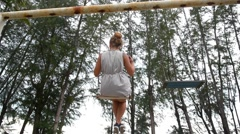 Carefree Woman is Swinging on a Swing in Park. Slow Motion. Stock Footage