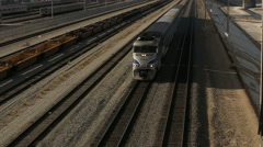 Overhead View of Train Passing Underneath on Sunny Day Stock Footage