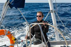 Woman at the helm - stock photo