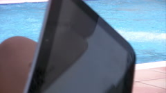 Woman hands holding digital tablet  near the pool Stock Footage