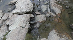 Water trickling down a rock five Stock Footage