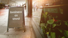 Blackboard Store Sign business as usual - stock footage