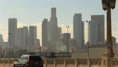 Warm Los Angeles City Skyline with Traffic on Foreground Bridge Stock Footage