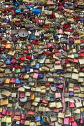 Padlocks at a fence on a bridge in cologne Stock Photos