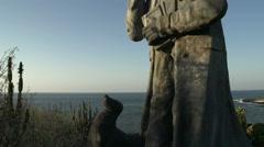 Tilt from Charles Darwin statue at Frigatebird hill san cristobal Stock Footage