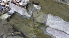 Water trickling down a rock three Stock Footage