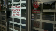 'No Loaded Weapons Beyond This Point' sign Stock Footage