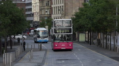 zoom out as buses pass albert memorial clock tower, belfast, northern ireland - stock footage