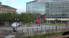 Tourists visit lagan riverside, the big fish, belfast, northern ireland Stock Footage