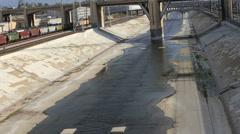 Dirty Los Angeles River Flows Under Bridge Concrete Stock Footage
