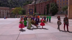 A Catholic religious procession arrives at the Montserrat Monastery in Spain. Stock Footage